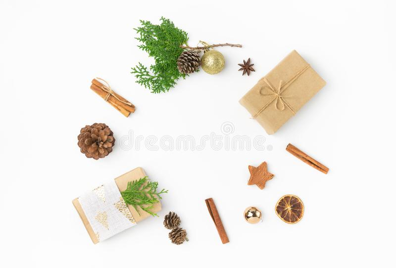 Christmas gift boxes wrapped in brown craft paper golden ribbon bow pine cones juniper cinnamon ornament ball arranged in circle stock images