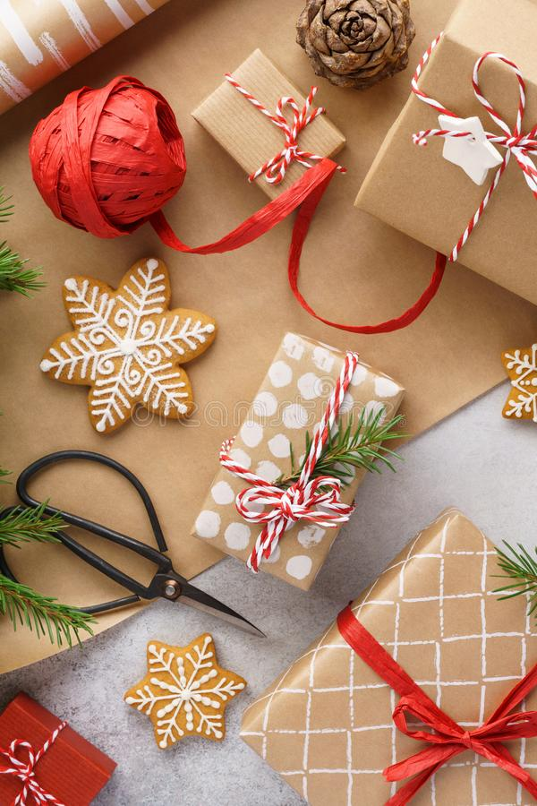 Christmas gift boxes, wrapping paper, cookies and red ribbon stock photography