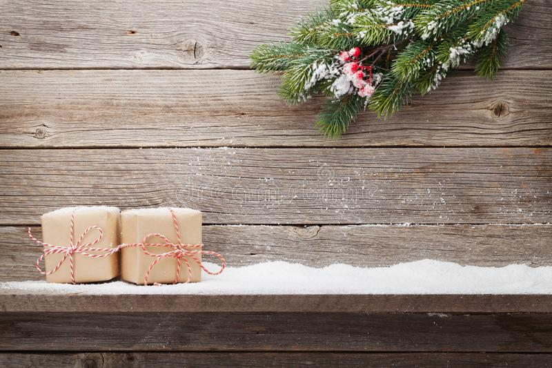 Christmas gift boxes and xmas fir tree royalty free stock images