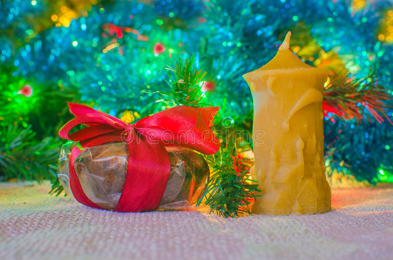 Christmas gift with candl stock photography