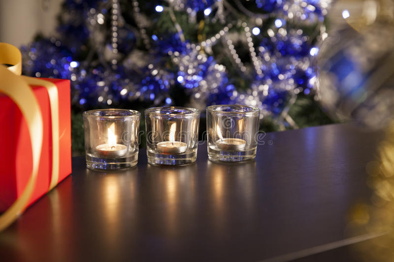 Christmas gift and candles stock image