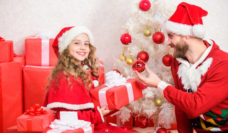 Christmas gift for child. Make your childs holiday extra special this year. Father christmas concept. Dad in santa royalty free stock photo
