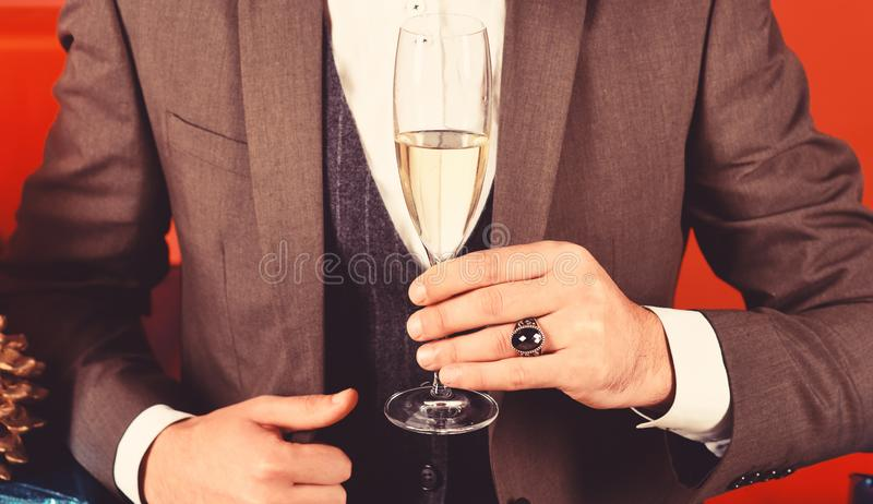 Christmas gift concept. Businessman holding glass of drink royalty free stock photos