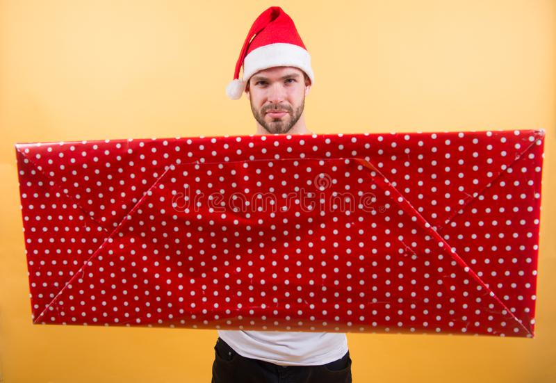Christmas gift concept. Santa bring gift for you. Man attractive santa claus carry big box. You deserve good gift. Christmas holiday celebration. Man handsome stock image