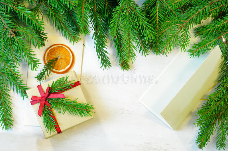 Christmas gift decorated with Christmas tree twig, envelope and stock image