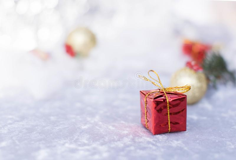Christmas gift on defocused lights background royalty free stock images