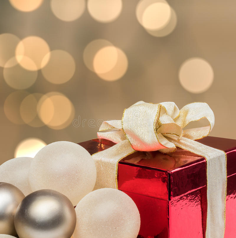 Christmas gift with defocused lights background. stock image