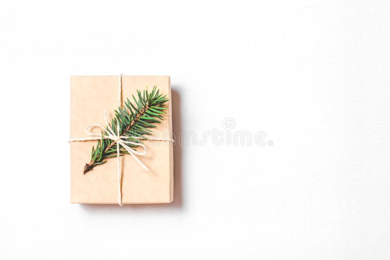 Christmas gift with fir branch on white background. Flat lay, top view. Copy space foryour text stock images