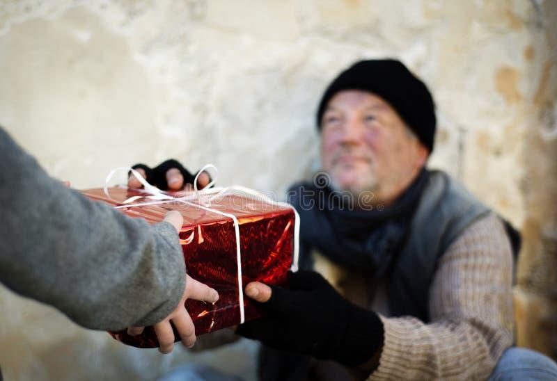 Christmas gift for homeless man royalty free stock photos