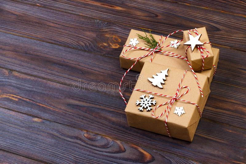 Christmas gift or New Year background: fir tree branch, star and snowflake decoration on a white wooden background stock image