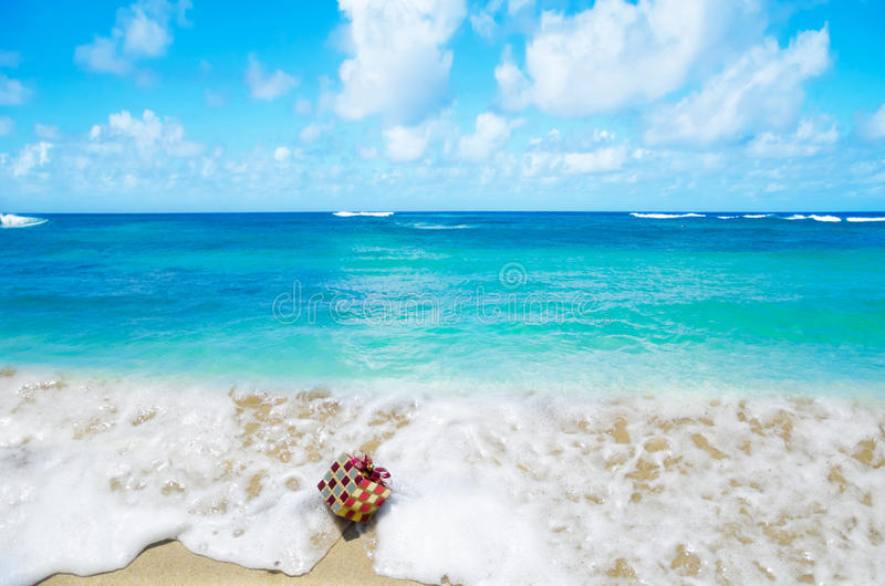 Christmas gift in the ocean - holiday concept stock photo