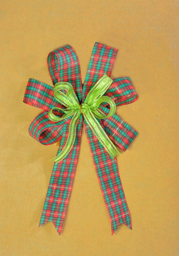 Christmas gift plaid bow. On brown paper stock photo