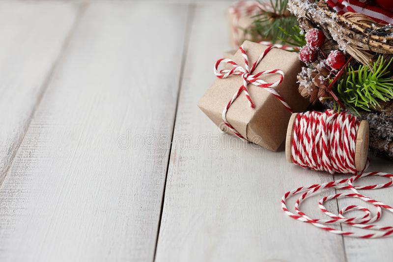 Christmas gift or present box wrapped in kraft paper royalty free stock image