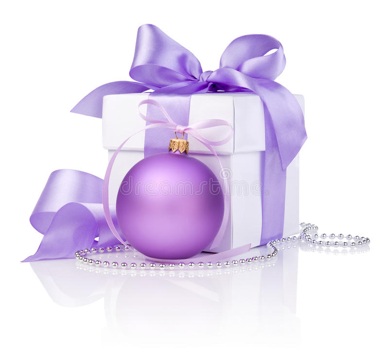 Christmas gift with purple ball and ribbon bow stock photo