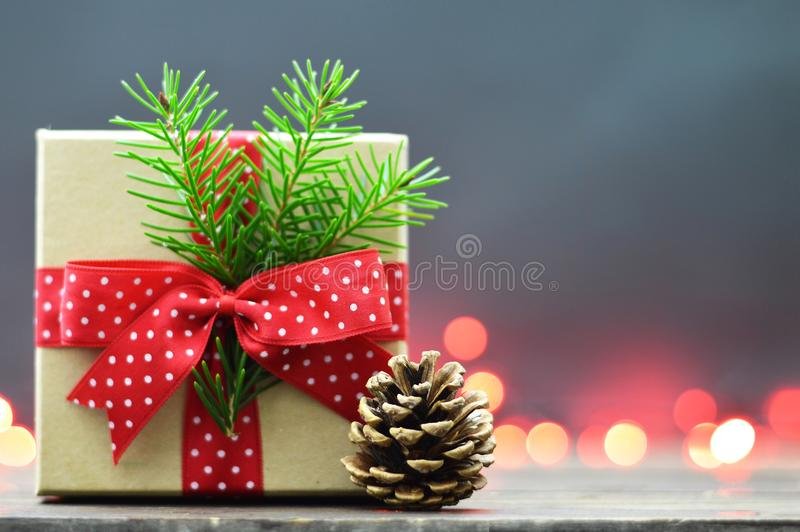 Christmas gift and pine cone royalty free stock photos