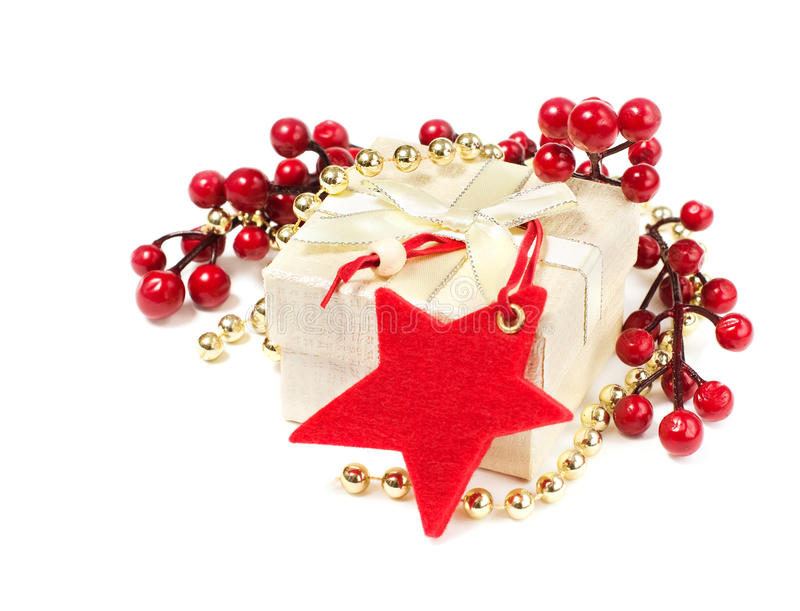 Christmas gift with red star and decorations stock photos