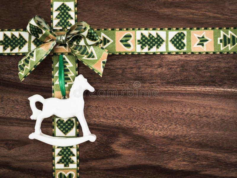 Christmas, gift ribbon on wood, christmas decoration, rocking ho royalty free stock photography