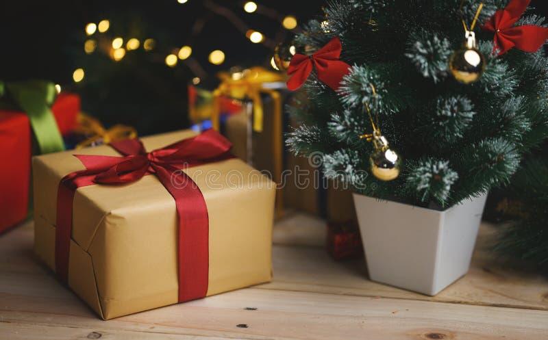 Christmas Gift And Small Christmas Tree stock image