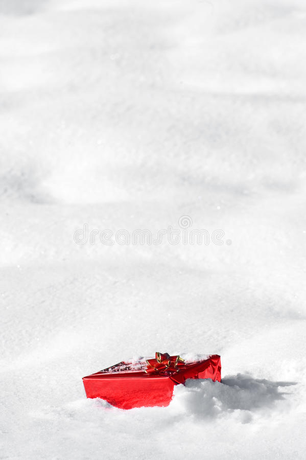 Download Christmas gift in the snow stock photo. Image of ribbon - 27534294