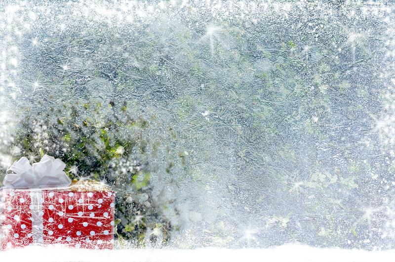 Christmas gift on the snow stock photography