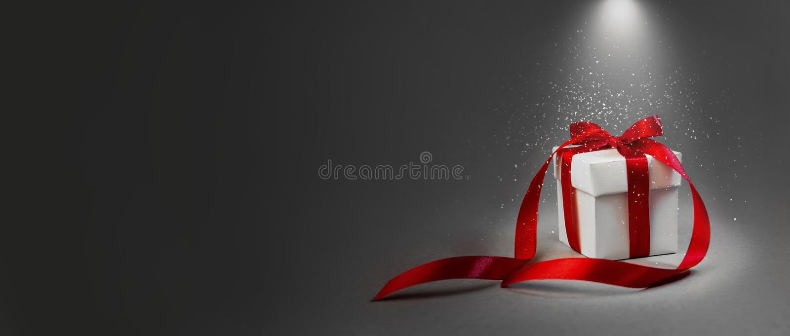 Christmas Gift White Box Red Ribbon Dark Grey Background Concept Night Illuminated Lantern New Year Holiday Composition Banner royalty free stock image