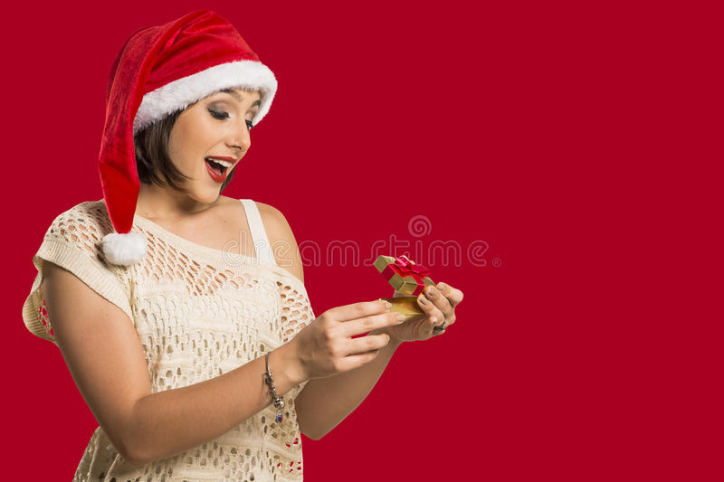 Christmas Gift - woman opening gift surprised and happy, Young b stock photos