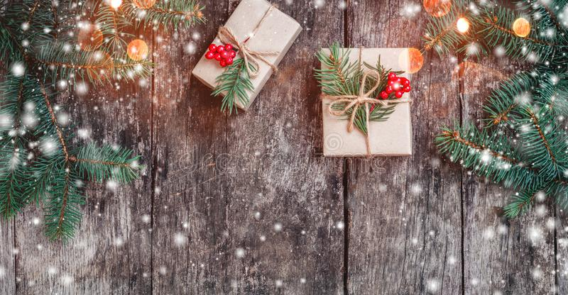 Christmas background with Christmas gift on wooden background with Fir branches. royalty free stock images