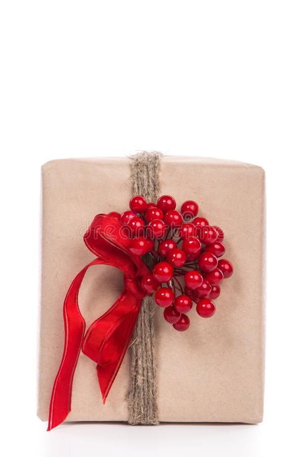 Christmas gift wrapped in craft and decorateed with twine with a stock images