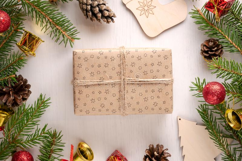 Christmas gift wrapped in craft paper with twine on white background royalty free stock photography