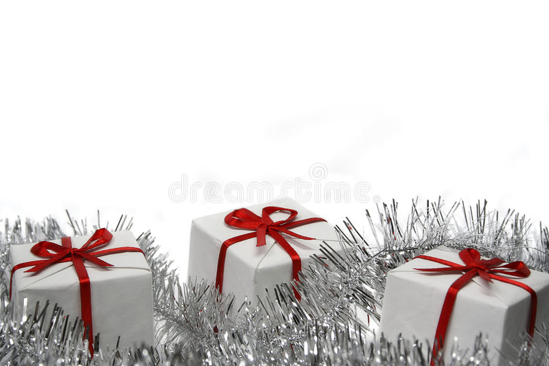 Christmas gifts. Three christmas gifts isolated on white