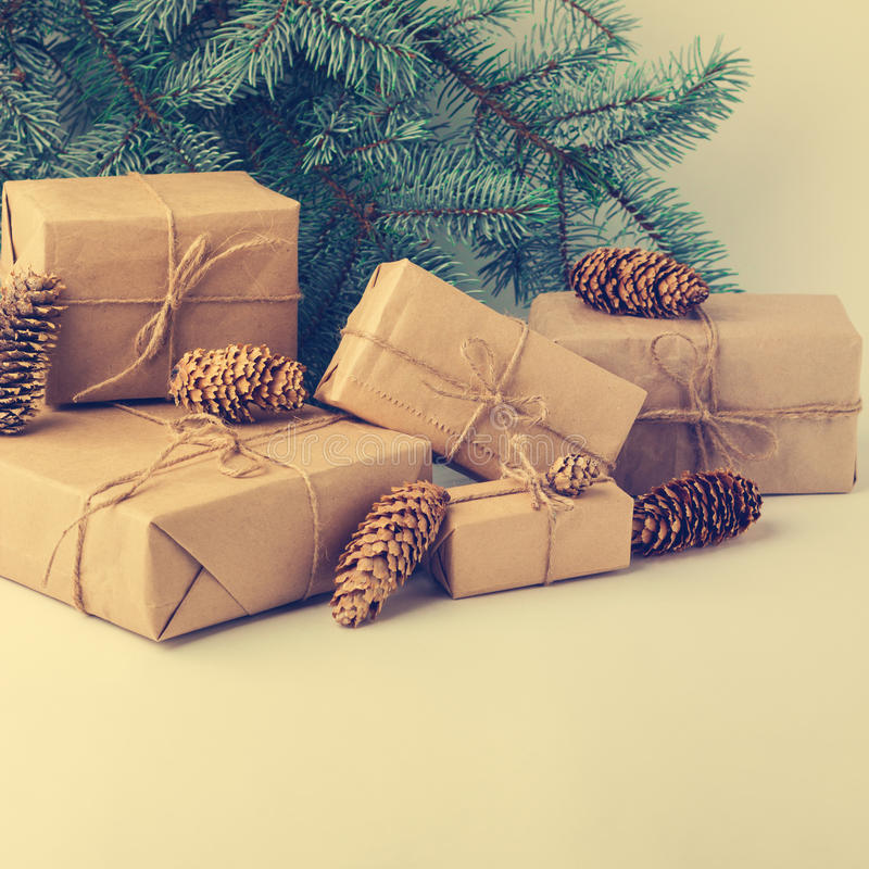 Christmas gifts against green fir branches. stock photography