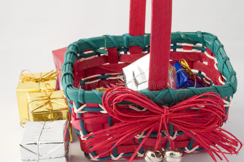 Christmas gifts in a basket stock photos