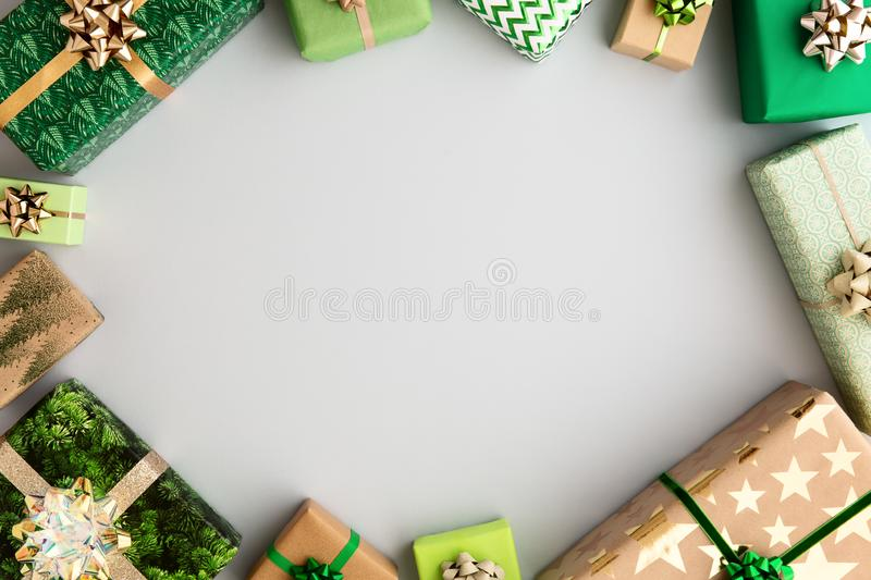 Christmas gifts border. Wrapped Christmas gifts forming a border royalty free stock photos