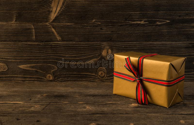Christmas gifts box present on dark wooden background. stock photos