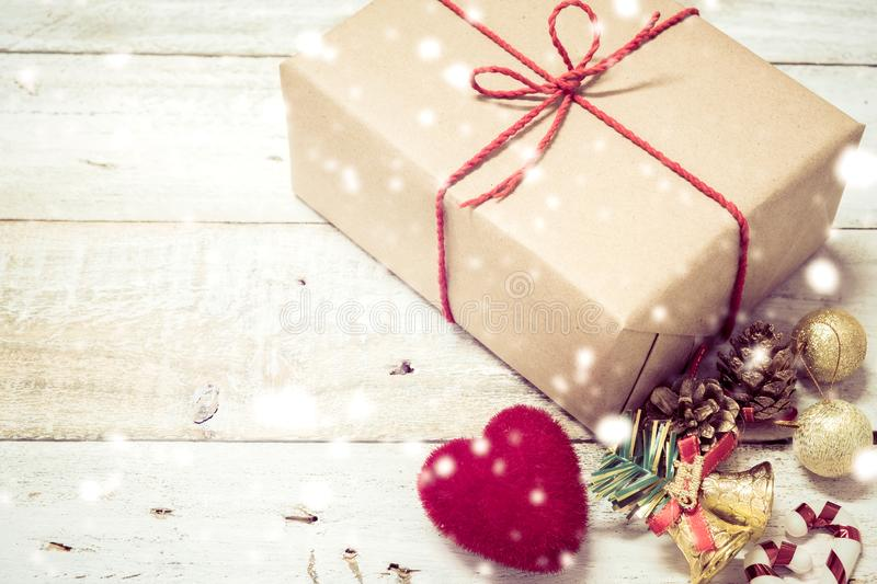 Christmas gifts box presents and heart on white wooden. Table with Christmas decoration royalty free stock images