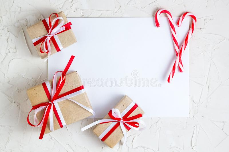 Christmas gifts and candy cane with with blank greeting card stock image