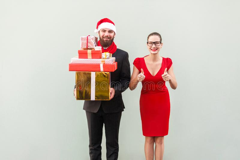 Christmas, gifts concept. Bearded businessman holding many gift royalty free stock image