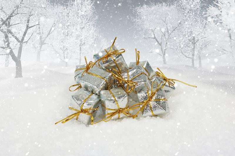 Christmas gifts in 3D snowy landscape. Silver Christmas gifts in a 3D snowy landscape stock photo