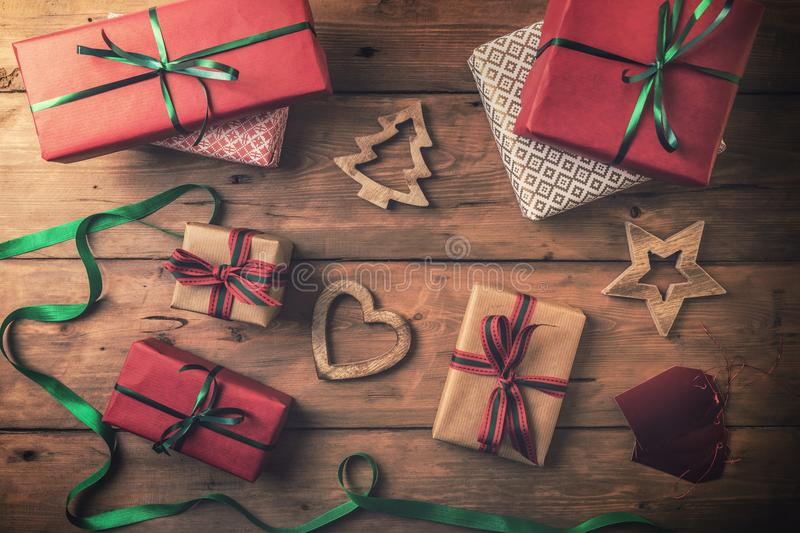 christmas gifts and decorations on brown wooden background stock photos