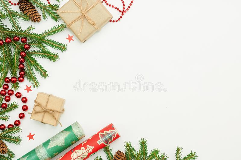 Christmas gifts and fur-tree branch stock photo
