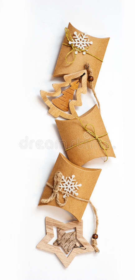 Christmas gifts in kraft paper with a homemade toys on white background stock image