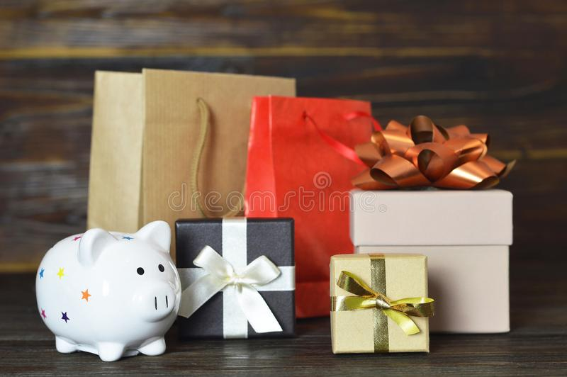 Christmas gifts and piggy bank. On wooden background royalty free stock photography