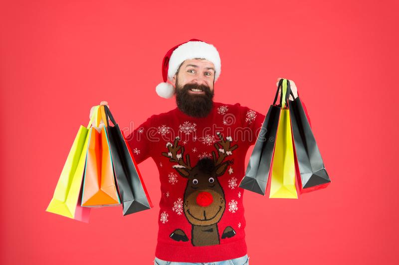Christmas gifts. Presents for family. Santa is coming. Bearded hipster carry shopping bags. Packages with gifts. Happy. Man bought gifts. Spending more than you royalty free stock photo