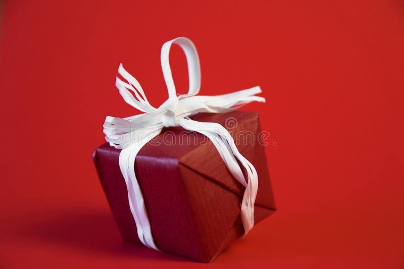 Christmas gifts presents on red background. Simple, classic, red and white wrapped gift boxes with ribbon bows and royalty free stock image