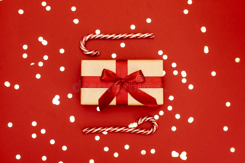 Christmas gifts presents on red background. Simple, classic, red and white wrapped gift boxes with ribbon bows and festive holiday stock photography