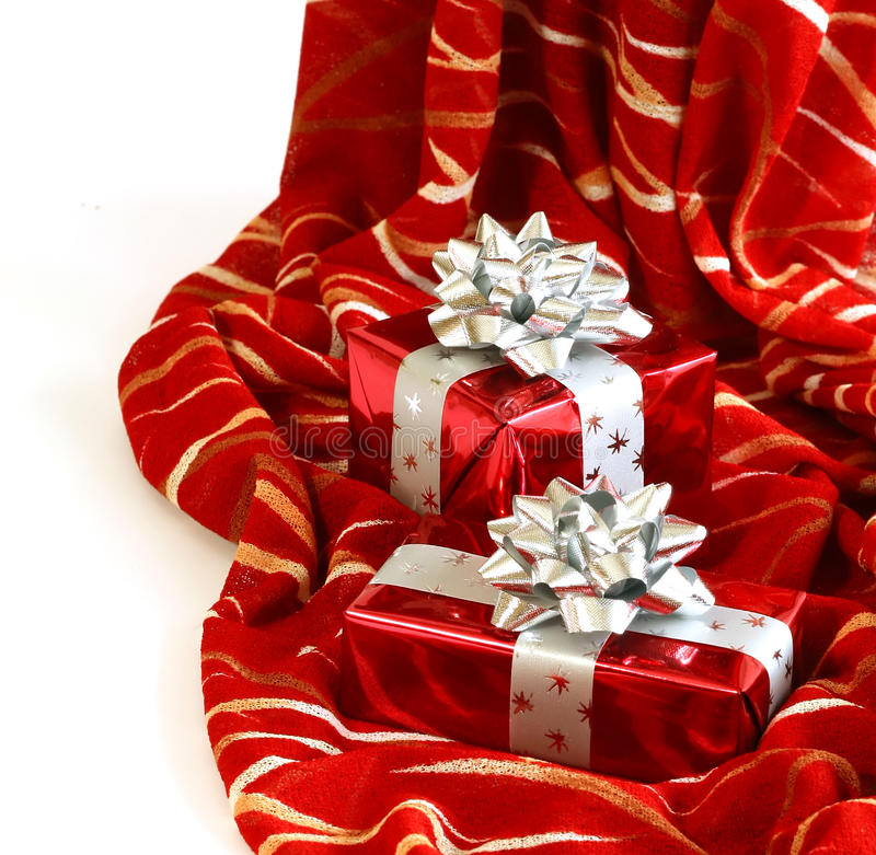 Christmas gifts on red. Two christmas gifts on a red background royalty free stock photo