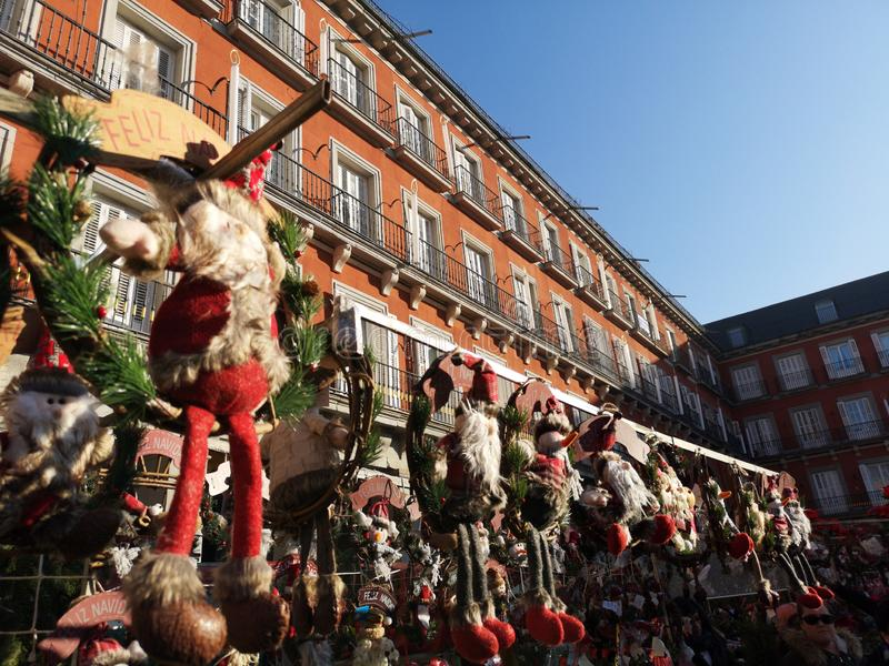 Christmas gifts sold in Plaza Mayor, main square, Madrid, Spain. The history of the Plaza Mayor in Madrid is the set of historical and urban events that stock photography