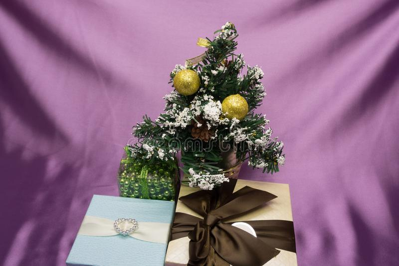 Christmas gifts under the tree stock image