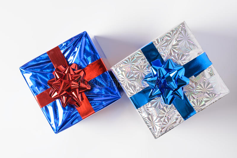 Christmas gifts on a white background. Two Christmas gifts on a white background royalty free stock photos