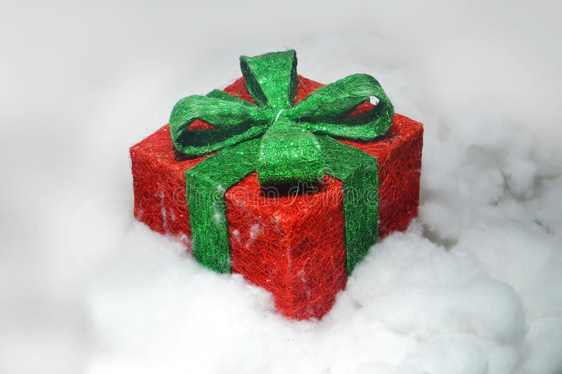 Christmas gifts. In white cloud stock image